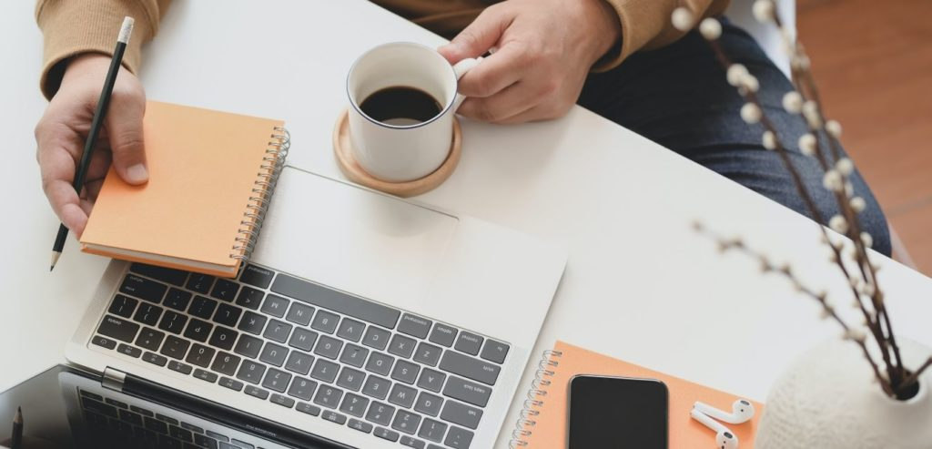 paper, hand, coffee, laptop - make better business decisions