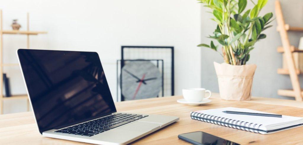 August 2020 Income Report - laptop, desk, clock, plant, phone