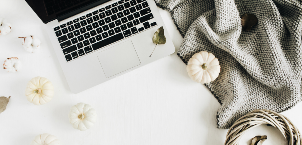 computer, white pumpkins, blanket - podcast production school october 2020 income report